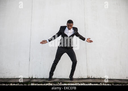 Young man in a suit street dancing - Stock Photo