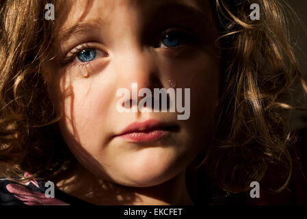 Young girl crying - Stock Photo