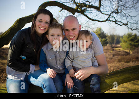 Family portrait outdoors - Stock Photo