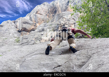 Freestyle Climber on the rock wall in the National Park Paklenica, Croatia - Stock Photo