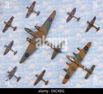 WW2 British Airfix model army planes on a sky cloud material background - Stock Photo