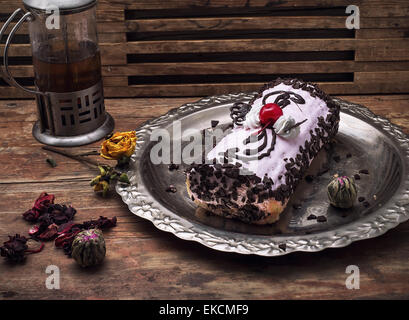 sweet roll on the iron tray and brew tea in glass - Stock Photo