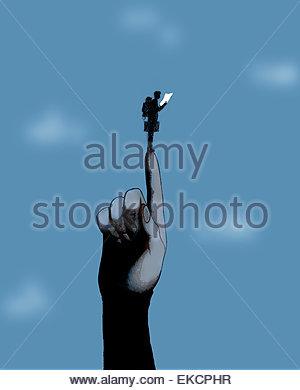 Large finger supporting businessman with backpack and map - Stock Photo