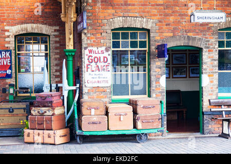 Luggage on yesteryear's, Sheringham railway station, North Norfolk, UK cases old platform travel trunks - Stock Photo
