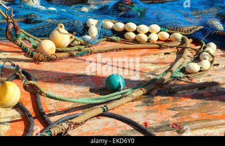 Fisherboat deck with net and tackle - Stock Photo