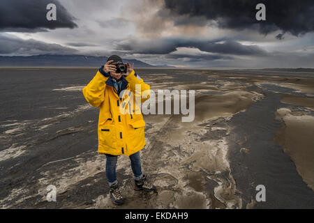Woman taking pictures at the eruption, Holuhraun Fissure,  Bardarbunga Volcano, Iceland - Stock Photo