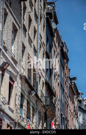 Ancient and historic maritime buildings surround the harbour quayside against blue sky, Honfleur Town, Normandy - Stock Photo