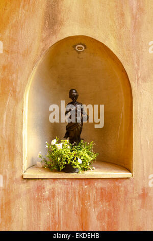 woman sculpture on wall - Stock Photo