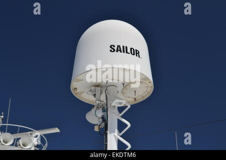 Cobham Sailor Ku-band satellite TV antenna on board a ship. - Stock Photo