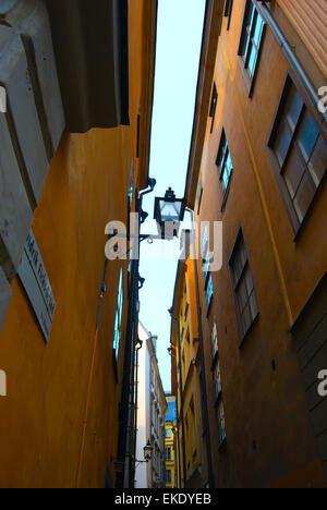 Narrow Street in Old Town (Gamla Stan) of Stockholm, Sweden. Looking up and see the sky - Stock Photo