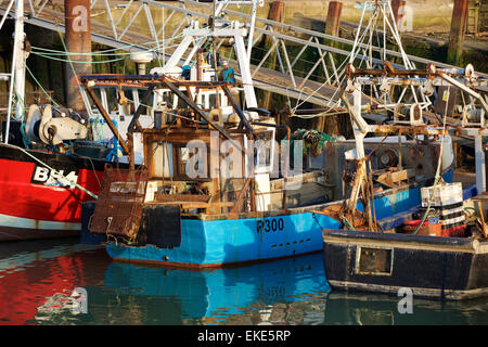 Collection of old fishing boats in Old Portsmouth showing detail of the fishing rig on the stern. - Stock Photo