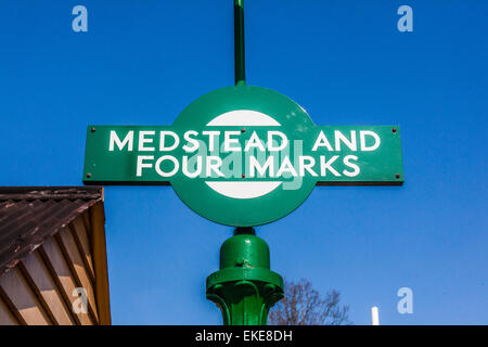 Sign for Medstead and Four Marks station, Hampshire, England, United Kingdom. - Stock Photo