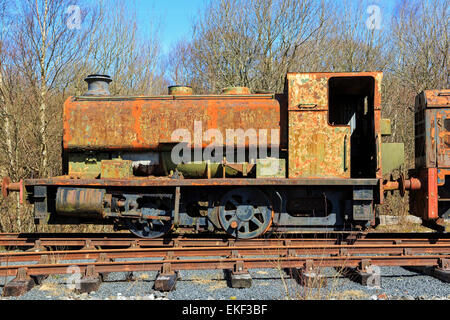 Rusting, disused and abandoned industrial tractive train parked on a siding, Ayrshire, Scotland, UK - Stock Photo