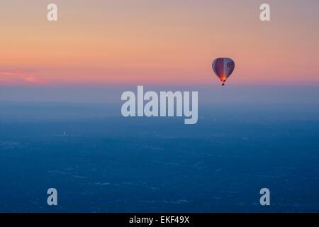 Tourists enjoy hot air balloon flights at sunrise over Melbourne, Australia.