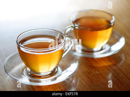 Two Glass Cups of Green Tea on the Wooden Table - Stock Photo