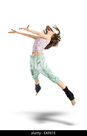 jumping young dancer isolated on white background - Stock Photo