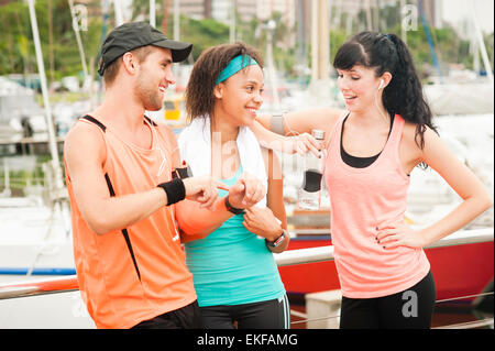 Group of young happy runners exercising early in the morning together - Stock Photo