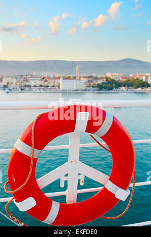 Lifebuoy on the ship deck. Split Old Town on the background. Croatia - Stock Photo