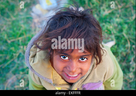 Unidentified indian boy looking at a cameraa in Delhi, India. 32.7% of the total Indian people fa - Stock Photo