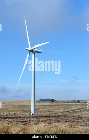 People walking below a wind driven turbine at the Whitelee wind farm visitor centre in East Renfrewshire, Scotland, - Stock Photo