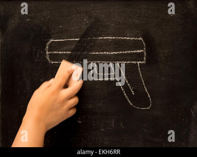 vintage illustration wiping gun on blackboard background - Stock Photo