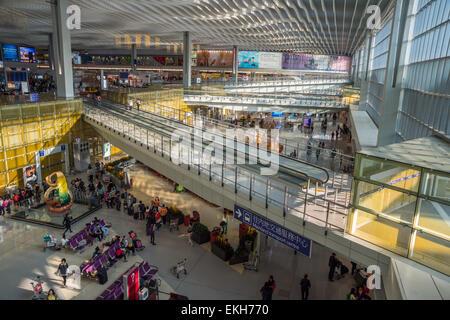 Passengers waiting for their flights at Hong-Kong Airport - Stock Photo