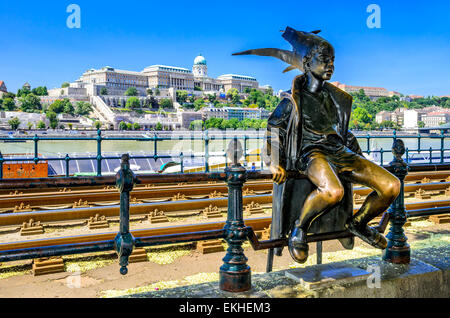 Little Princess perched by the tram rails on the Pest, with Buda Castle in background, landmark - Stock Photo
