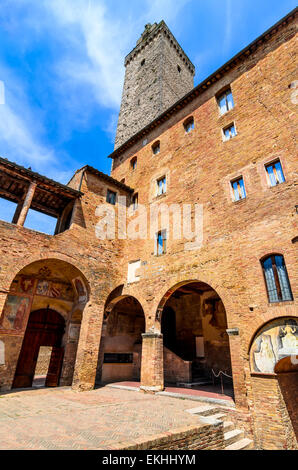 San Gimignano, Tuscany. Torre Grossa and Palazzo Podesta courtyard, landmark of beautiful tuscan city in Italy. - Stock Photo