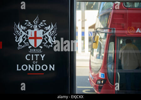 LONDON, UK - APRIL 06: Detail of black City of London banner in bus stop featuring its coat of arms, with front - Stock Photo