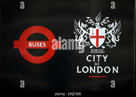 LONDON, UK - APRIL 06: Detail of black City of London banner in bus stop featuring its coat of arms next to the - Stock Photo