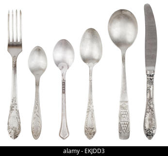 Aged vintage silver cutlery (fork, knife, spoons) isolated on white background. File contains a clipping path. - Stock Photo