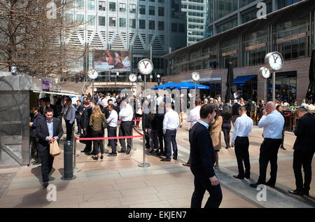 office workers standing in lunchtime queue, canary wharf, london, england - Stock Photo