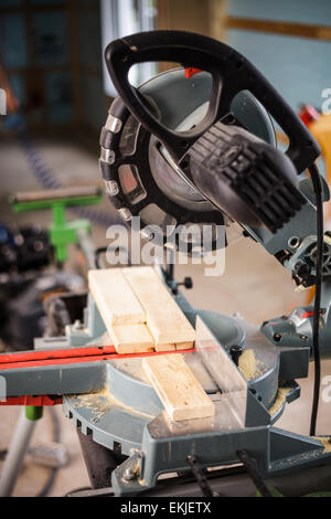 Miter Saw on a house construction site - Stock Photo