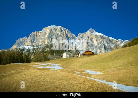 Corvara in Badia with Dolomites Dolomiti alps in background - Trentino Alto Adige, South Tyrol, Norther Italy - Stock Photo