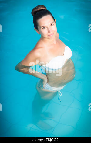 Young Pregnant Woman In A Bikini Under Water In The Pool Stock Photo Royalty Free Image