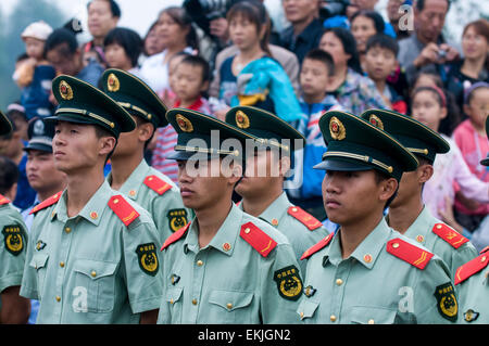 Army soldiers stan at attention during ceremony in walled city of Pingyao, Shanxi Province, China. - Stock Photo