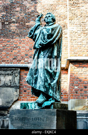 A large statue of religious reformer Martin Luther in Hannover, Germany outside the historic Marktkirche church. - Stock Photo