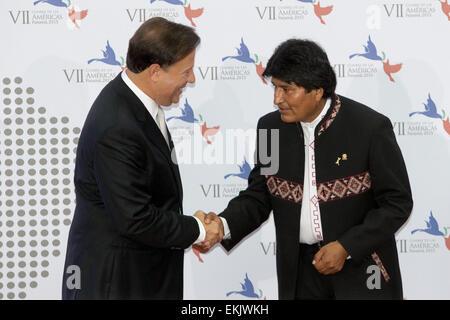Panama City, Panama. 10th Apr, 2015. Panama's President Juan Carlos Varela (L) welcomes Bolivia's President Evo - Stock Photo
