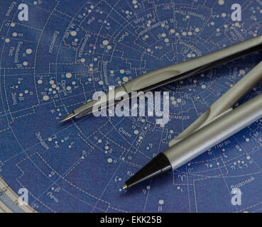 compasses on the map - Stock Photo