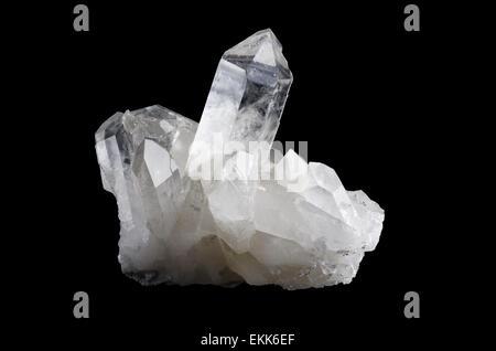 Quartz crystal cluster horizontal on black background, mineral also a semi-precious gemstone. Silica, silicon dioxide, - Stock Photo