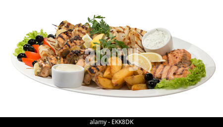 Large dish with seafood on the grill on  an isolated background - Stock Photo