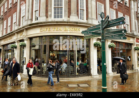 YORK, UNITED KINGDOM - APRIL 2010: Rainy day in York, England. The famous Betty's Tea Rooms at Helenas Square in - Stock Photo