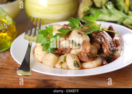 potato gnocchi with mushrooms and parsley - Stock Photo