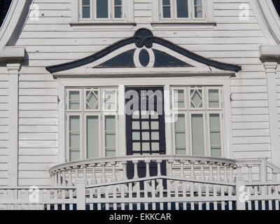 Detail of facade of upscale wooden villa in old residential area of Stavanger Norway, white wooden paneled wall, - Stock Photo