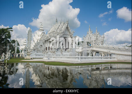 Wat Rong Khun better known to foreigners as the White Temple, is a contemporary Art Exhibit in the form of a Buddhist - Stock Photo