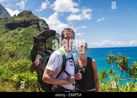 Hikers with baby on the Kalalau Trail on Kauai - Stock Photo