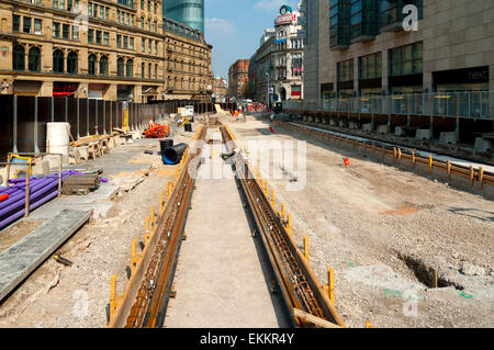 Tram tracks at the site of the future Metrolink tram stop, Exchange Square, Manchester, England, UK. - Stock Photo