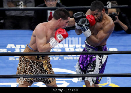 Brooklyn, New York, USA. 11th Apr, 2015. DANNY GARCIA and LAMONT PETERSON (purple trunks) battle in a welterweight - Stock Photo