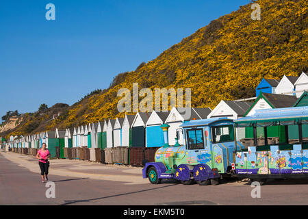 Bournemouth, Dorset, UK. 12th April, 2015. UK Weather: Runner jogging along Bournemouth promenade under sunny blue - Stock Photo