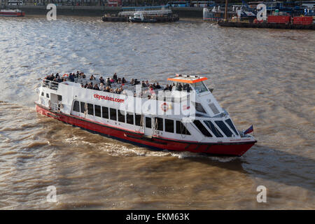A City Cruises pleasure boat on the River Thames in London - Stock Photo